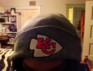 Dina wearing a chiefs hat